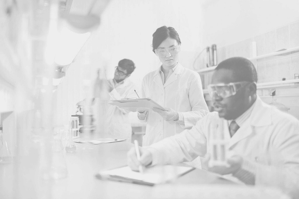 Diverse team of researchers working a lab
